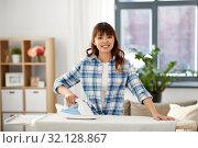Купить «asian woman ironing bed linen at home», фото № 32128867, снято 13 апреля 2019 г. (c) Syda Productions / Фотобанк Лори