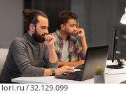 Купить «creative team with computer working late at office», фото № 32129099, снято 24 января 2018 г. (c) Syda Productions / Фотобанк Лори