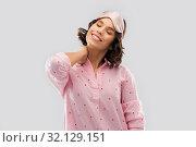 Купить «happy young woman in pajama and eye sleeping mask», фото № 32129151, снято 6 марта 2019 г. (c) Syda Productions / Фотобанк Лори