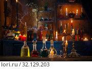 Купить «magic potions in bottles on wooden background», фото № 32129203, снято 11 августа 2019 г. (c) Майя Крученкова / Фотобанк Лори