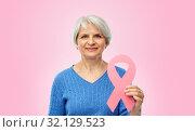 Купить «old woman with pink breast cancer awareness ribbon», фото № 32129523, снято 28 апреля 2019 г. (c) Syda Productions / Фотобанк Лори