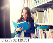 Купить «high school student girl reading book at library», фото № 32129731, снято 19 июня 2016 г. (c) Syda Productions / Фотобанк Лори