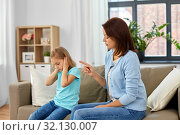 angry mother scolding her daughter at home. Стоковое фото, фотограф Syda Productions / Фотобанк Лори