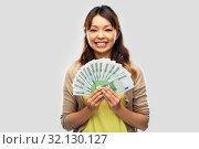 Купить «asian woman with hundred euro money banknotes», фото № 32130127, снято 11 мая 2019 г. (c) Syda Productions / Фотобанк Лори