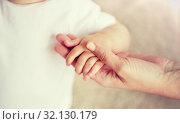 Купить «close up of little baby and mother hands», фото № 32130179, снято 12 июля 2016 г. (c) Syda Productions / Фотобанк Лори