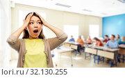 Купить «stressed asian woman holding to her head at school», фото № 32130255, снято 11 мая 2019 г. (c) Syda Productions / Фотобанк Лори