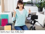 Купить «female blogger making video blog about shopping», фото № 32130327, снято 13 апреля 2019 г. (c) Syda Productions / Фотобанк Лори