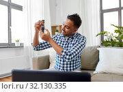 Купить «male blogger recording video review of smart watch», фото № 32130335, снято 21 апреля 2019 г. (c) Syda Productions / Фотобанк Лори