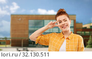 Купить «red haired teenage girl showing peace over school», фото № 32130511, снято 28 февраля 2019 г. (c) Syda Productions / Фотобанк Лори