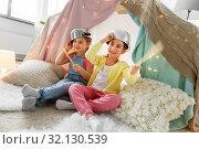Купить «girls with pots playing in kids tent at home», фото № 32130539, снято 18 февраля 2018 г. (c) Syda Productions / Фотобанк Лори