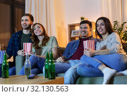 Купить «friends with beer and popcorn watching tv at home», фото № 32130563, снято 22 декабря 2018 г. (c) Syda Productions / Фотобанк Лори