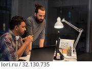 Купить «creative team with computer working late at office», фото № 32130735, снято 24 января 2018 г. (c) Syda Productions / Фотобанк Лори