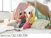 Купить «girls with pots playing in kids tent at home», фото № 32130739, снято 18 февраля 2018 г. (c) Syda Productions / Фотобанк Лори