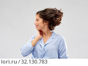 Купить «happy young woman in pajama over grey background», фото № 32130783, снято 6 марта 2019 г. (c) Syda Productions / Фотобанк Лори