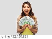 Купить «asian woman with hundred euro money banknotes», фото № 32130831, снято 11 мая 2019 г. (c) Syda Productions / Фотобанк Лори