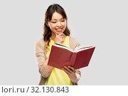 Купить «happy asian woman reading book», фото № 32130843, снято 11 мая 2019 г. (c) Syda Productions / Фотобанк Лори