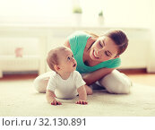 Купить «happy mother playing with baby at home», фото № 32130891, снято 12 июля 2016 г. (c) Syda Productions / Фотобанк Лори