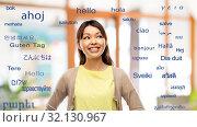 Купить «asian woman looking up over foreign languages», фото № 32130967, снято 11 мая 2019 г. (c) Syda Productions / Фотобанк Лори
