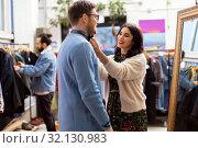 Купить «couple choosing clothes at vintage clothing store», фото № 32130983, снято 30 ноября 2017 г. (c) Syda Productions / Фотобанк Лори