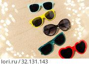 different sunglasses on beach sand. Стоковое фото, фотограф Syda Productions / Фотобанк Лори