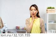 Купить «surprised asian woman over kitchen background», фото № 32131155, снято 11 мая 2019 г. (c) Syda Productions / Фотобанк Лори