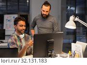 Купить «creative team with computer working late at office», фото № 32131183, снято 24 января 2018 г. (c) Syda Productions / Фотобанк Лори