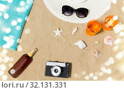 Купить «drinks, hat, camera and sunglasses on beach sand», фото № 32131331, снято 27 июня 2018 г. (c) Syda Productions / Фотобанк Лори