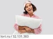 Купить «woman with pillow in pajama and eye sleeping mask», фото № 32131383, снято 6 марта 2019 г. (c) Syda Productions / Фотобанк Лори