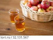 Купить «apples in basket and glasses of juice on table», фото № 32131567, снято 24 августа 2018 г. (c) Syda Productions / Фотобанк Лори