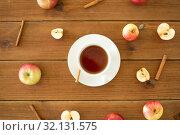 Купить «cup of tea with apples and cinnamon on table», фото № 32131575, снято 24 августа 2018 г. (c) Syda Productions / Фотобанк Лори