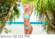 Купить «young woman posing in bikini on beach», фото № 32131759, снято 20 апреля 2017 г. (c) Syda Productions / Фотобанк Лори
