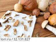 Купить «dried mushrooms on baking paper», фото № 32131827, снято 13 сентября 2018 г. (c) Syda Productions / Фотобанк Лори