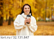 Купить «woman with hot drink in tumbler at autumn park», фото № 32131847, снято 13 октября 2018 г. (c) Syda Productions / Фотобанк Лори