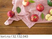 Купить «ripe red apples on wooden table», фото № 32132043, снято 24 августа 2018 г. (c) Syda Productions / Фотобанк Лори