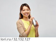 Купить «happy asian woman with can drink», фото № 32132127, снято 11 мая 2019 г. (c) Syda Productions / Фотобанк Лори