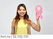 Купить «asian woman with breast cancer awareness ribbon», фото № 32132131, снято 11 мая 2019 г. (c) Syda Productions / Фотобанк Лори