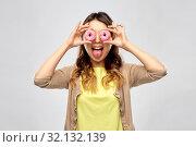 Купить «asian woman with eyes of donuts showing tongue», фото № 32132139, снято 11 мая 2019 г. (c) Syda Productions / Фотобанк Лори
