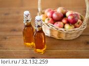 Купить «apples in basket and bottles of juice on table», фото № 32132259, снято 24 августа 2018 г. (c) Syda Productions / Фотобанк Лори