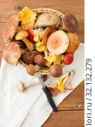 Купить «basket of different edible mushrooms and knife», фото № 32132279, снято 13 сентября 2018 г. (c) Syda Productions / Фотобанк Лори