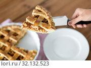 Купить «close up of hand with piece of apple pie on knife», фото № 32132523, снято 23 августа 2018 г. (c) Syda Productions / Фотобанк Лори
