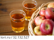 Купить «apples in basket and glasses of juice on table», фото № 32132527, снято 24 августа 2018 г. (c) Syda Productions / Фотобанк Лори