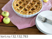 Купить «apple pie in baking mold on wooden table», фото № 32132783, снято 23 августа 2018 г. (c) Syda Productions / Фотобанк Лори