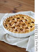Купить «close up of apple pie in mold on wooden table», фото № 32133051, снято 23 августа 2018 г. (c) Syda Productions / Фотобанк Лори
