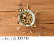 Купить «dried mushrooms in bowl on wooden background», фото № 32133115, снято 13 сентября 2018 г. (c) Syda Productions / Фотобанк Лори
