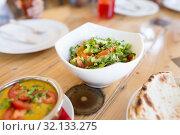 Купить «vegetable salad in bowl at indian restaurant», фото № 32133275, снято 2 мая 2017 г. (c) Syda Productions / Фотобанк Лори