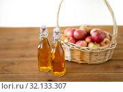 Купить «apples in basket and bottles of juice on table», фото № 32133307, снято 24 августа 2018 г. (c) Syda Productions / Фотобанк Лори