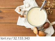 Купить «mushroom cream soup in bowl on cutting board», фото № 32133343, снято 13 сентября 2018 г. (c) Syda Productions / Фотобанк Лори