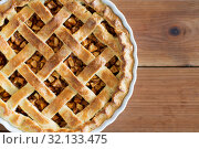 Купить «close up of apple pie in mold on wooden table», фото № 32133475, снято 23 августа 2018 г. (c) Syda Productions / Фотобанк Лори