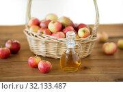 Купить «apples in basket and jug of vinegar on table», фото № 32133487, снято 24 августа 2018 г. (c) Syda Productions / Фотобанк Лори
