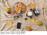 Купить «smartphone, hot chocolate and camera in autumn», фото № 32133547, снято 26 октября 2018 г. (c) Syda Productions / Фотобанк Лори